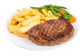 Juicy beef ribeye steak with french fries and green beans from above over white background Royalty Free Stock Photography