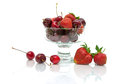 Juicy cherries and strawberries in a glass bowl isolated on whi Royalty Free Stock Photo