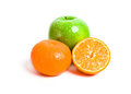 Juicy cut orange and green apple Royalty Free Stock Photography