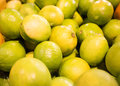 Juicy fresh limes at market Royalty Free Stock Photography