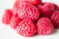 Juicy fresh ripe red raspberries on white Royalty Free Stock Photo