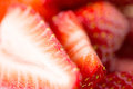 Juicy fresh ripe red strawberry slices fruits berries diet eco food and objects concept Royalty Free Stock Images