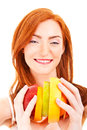 Juicy fruit A close-up of a pretty lady's face with a fresh Royalty Free Stock Photos