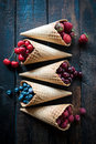 Juicy fruits in the ice cream cones Royalty Free Stock Photo