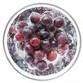 Juicy full bodied grapes in a wine glass rich dark Stock Photography