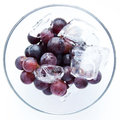 Juicy full bodied grapes in a wine glass rich with ice Royalty Free Stock Images