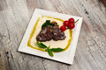 Juicy grilled beef steak and mushrooms with tomatoes Royalty Free Stock Photo