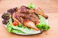 Juicy grilled roast chicken with herb, lettuce and tomato garnis Royalty Free Stock Photo
