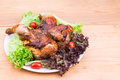 Juicy grilled roast chicken with herb, salad and tomato garnish Royalty Free Stock Photo