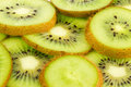 Juicy kiwi fruit slices background Royalty Free Stock Photos