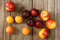 Juicy nectarines and apricots on wooden table Royalty Free Stock Photography