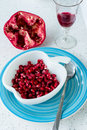 Juicy pomegranate red in the blue plate on the table Stock Photo