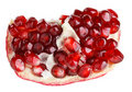 Juicy ripe open pomegranate piece Royalty Free Stock Images