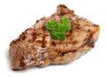 Juicy sirloin beef steak isolated on white seasoned and chargrilled Royalty Free Stock Image