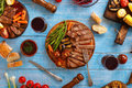 Juicy steak grilled with grilled vegetables and red wine Royalty Free Stock Photo