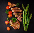 Juicy steak medium rare beef with spices and asparagus Royalty Free Stock Photo