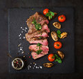 Juicy steak medium rare beef with spices Royalty Free Stock Photo