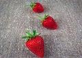 Juicy strawberries on linen fabric closeup three Royalty Free Stock Photography