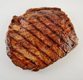 Juicy thick medallion of lean flank beef steak Royalty Free Stock Photo