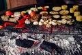 Juicy vegetables and meat grilling. beef steak mushrooms corn pe Royalty Free Stock Photo