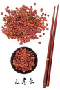 Jujube seed used in traditional chinese herbal medicine with mandarin title script translation and chopsticks suan zao ren Royalty Free Stock Images