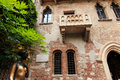 Juliet's balcony and Juliet statue - Verona in Italy Royalty Free Stock Photo