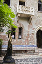 Juliet in verona courtyard and balcony of the s house from romeo and by w shakespeare italy statue was created s century Royalty Free Stock Image