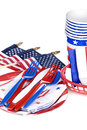 July fourth utensils patriotic including plastic forks knives spoons napkins plates and cups on a white background Stock Images
