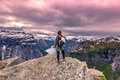 July 22, 2015: Traveller at the edge of Trolltunga, Norway Royalty Free Stock Photo