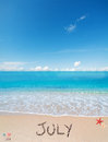 July on a tropical beach under clouds Royalty Free Stock Photo
