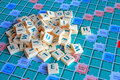 Jumbled pile of scrabble tiles photo a letter on gaming board Royalty Free Stock Photography