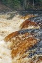 Jumbled Waters on a Flooded Falls Royalty Free Stock Photo