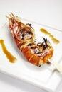 Jumbo shrimp on stick lying a plate Royalty Free Stock Photos