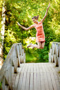 Jump girl on summer bridge Royalty Free Stock Photo