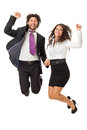 Jump if you like business an handsome businessman and a gorgeous businesswoman jumping over a white background Stock Photo