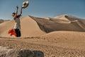 Jump of joy at Mingsha sand dunes