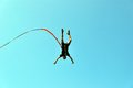 Jump off a cliff with a rope.Bungee jumping Royalty Free Stock Photo