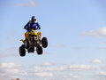 Jump on quadrocycle nadym russia august extreme sport vadim vasyuhin in jumping an view of the city homes Stock Photography