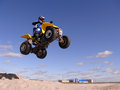 Jump on quadrocycle nadym russia august extreme sport vadim vasyuhin in jumping an view of the city homes Royalty Free Stock Photo