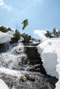 Jump snowboarding young man jumping with snowboard over the river Stock Photography