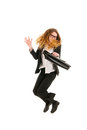 Jumping business woman with bag isolated over whsite background Stock Image
