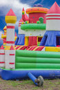 Jumping castle, playground for kids with slides Royalty Free Stock Photo
