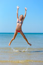 Jumping child at the beach full of energy Royalty Free Stock Images