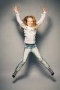 Jumping child happy little girl studio shot Stock Images