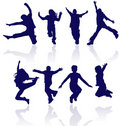 Group of happy school children active jumping dancing running playing kids kid child silhouettes fun sport party jumps jump dance Royalty Free Stock Photo