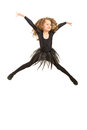 Jumping dancer girl in black dress isolated on white background Stock Photo