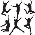 Jumping female silhouettes on white Stock Photo