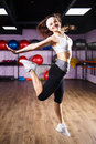Jumping fitness girl doing zumba dancing exercises Royalty Free Stock Photo