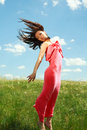 Jumping and flying graceful girl on the background of blue sky clouds Royalty Free Stock Photos