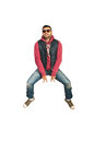 Jumping and gesturing rapper man isolated on white background Stock Photo